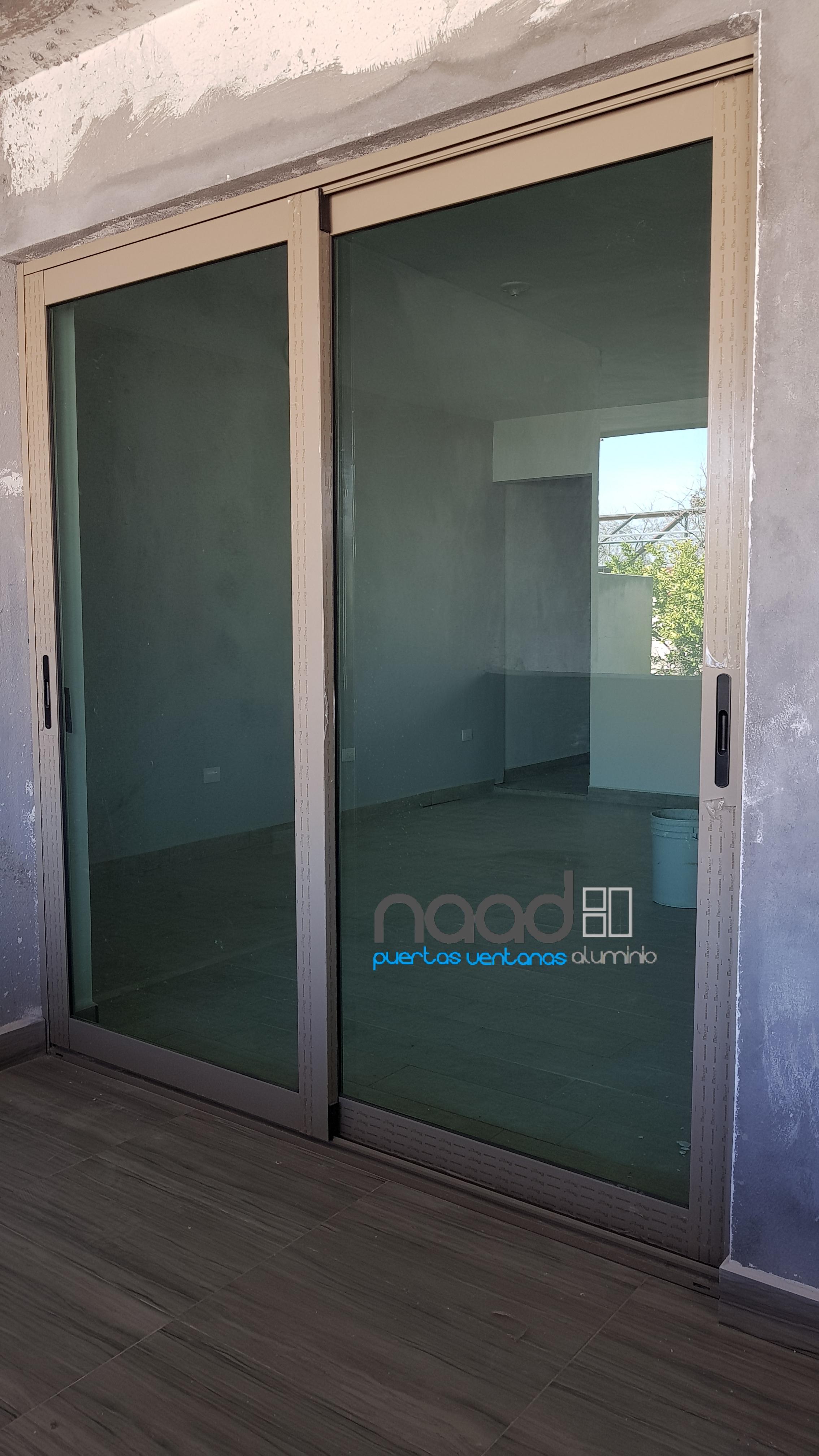Naad puertas y ventanas de aluminio for Puertas corredizas de metal