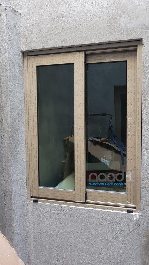 Ventana corrediza de aluminio serie 70 naad for Puerta ventana corrediza aluminio